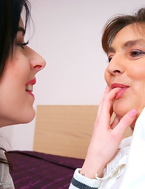 Naughty old and young lesbian couple playing