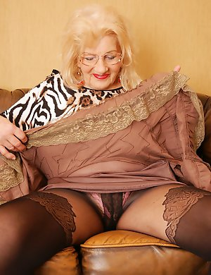 Naughty granny getting ready to play with herself
